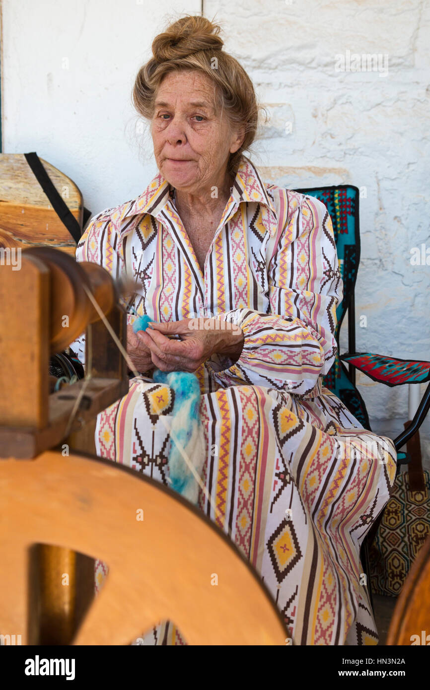 Fort Stanton, New Mexico - Women demonstrate spinning wool during 'Fort Stanton Live!,' an annual living - Stock Image