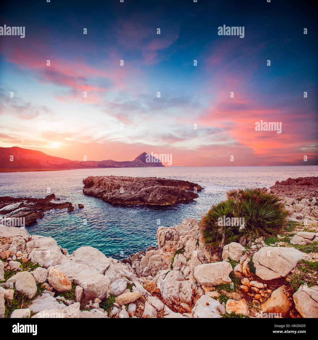 Sea coast at sunset - Stock Image