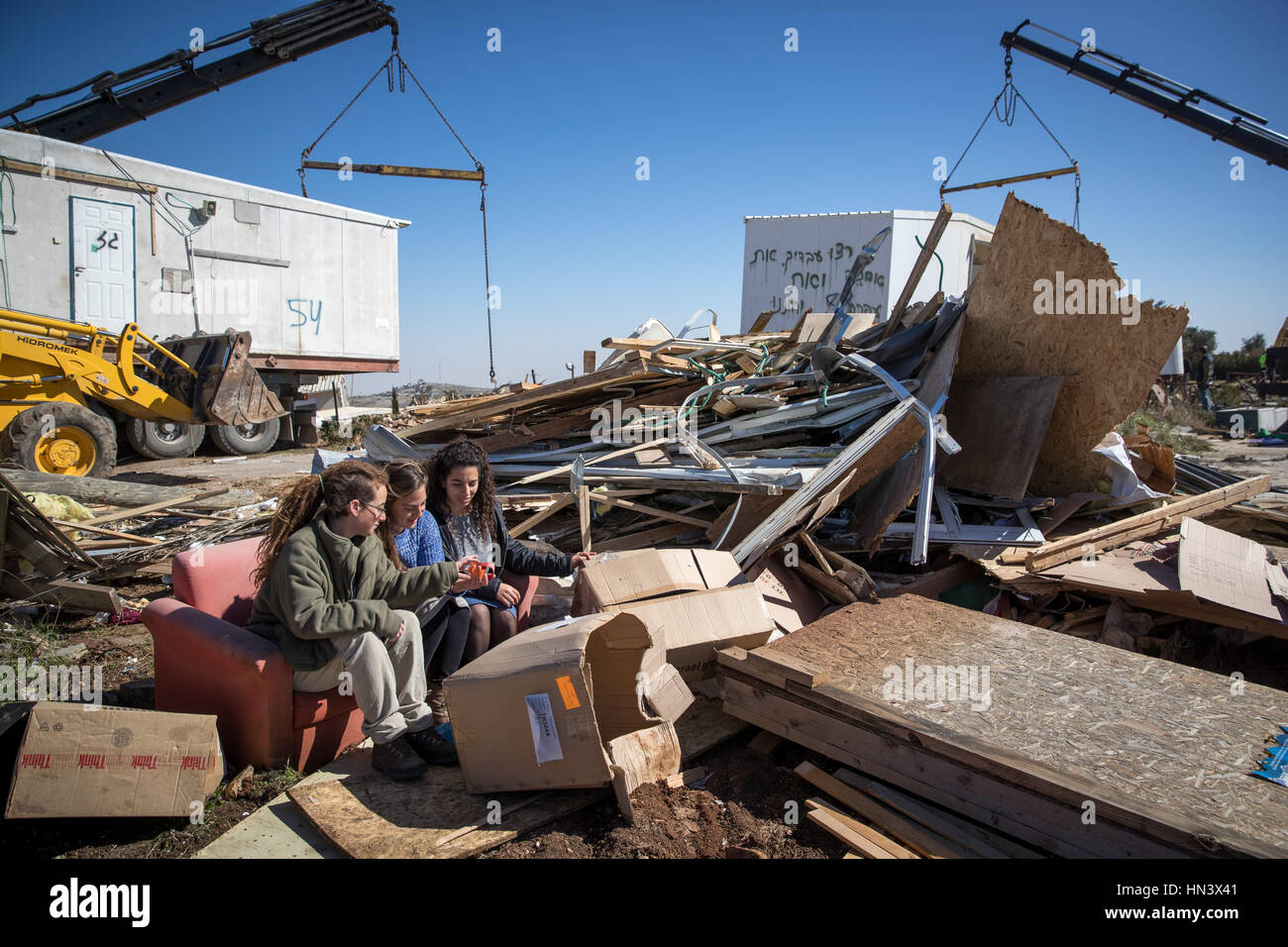 Amona. 7th Feb, 2017. An unauthorized building is being removed from the illegal settlement outpost of Amona inside - Stock Image