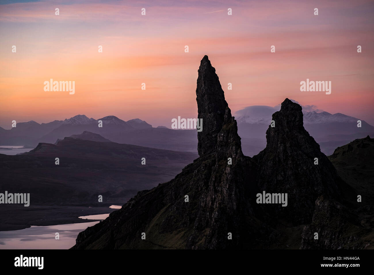 A pre dawn sky filled with oranges and pinks over the Old Man of Storr on the Isle of Skye. Stock Photo