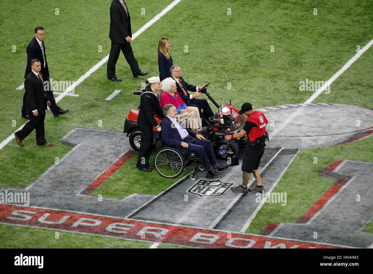 February 05, 2017 President George H.W. Bush and his wife Barbara Bush took to center field to perform the coin - Stock Image