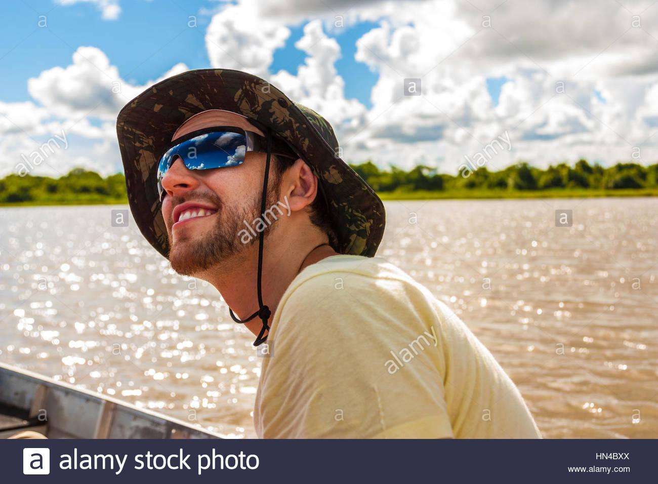 Young man exploring a wetlands in Pantanal, Brazil - Stock Image