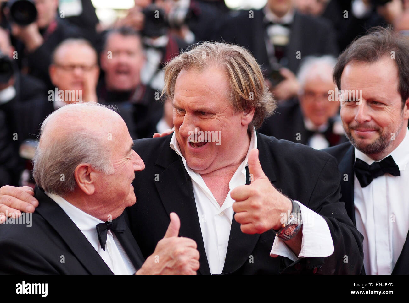FIFA President Sepp Blatter, Gerard Depardieu and director Frederic Auburtin attend the premiere of The Homesman - Stock Image