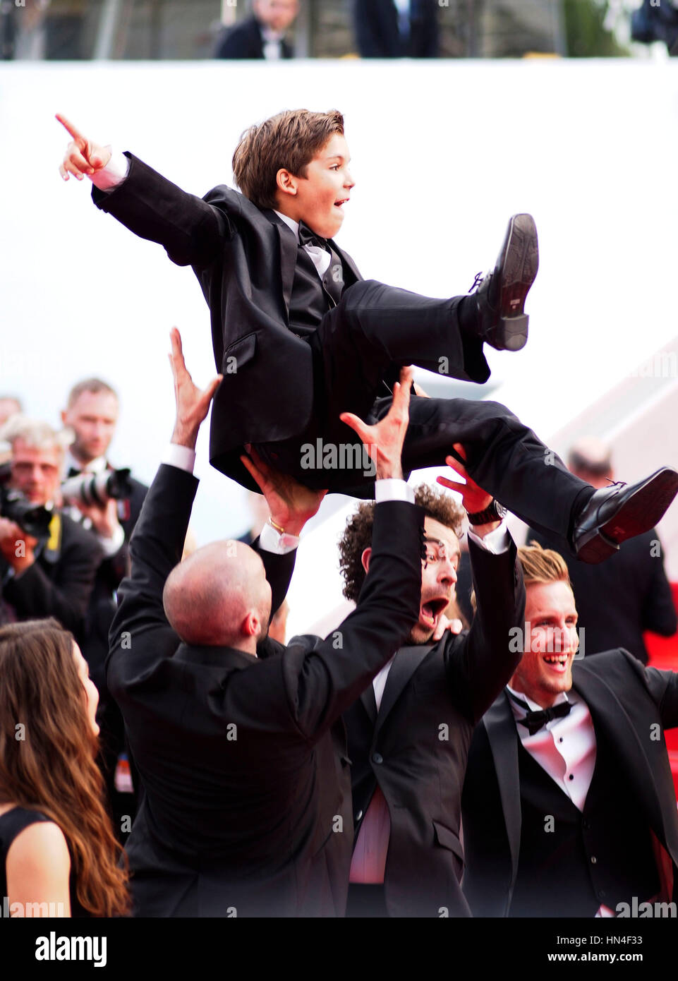 Enzo tomasini is thrown into the air by the cast of babysitting at enzo tomasini is thrown into the air by the cast of babysitting at the premiere for the film how to train your dragon 2 at the cannes film festival on may ccuart Image collections
