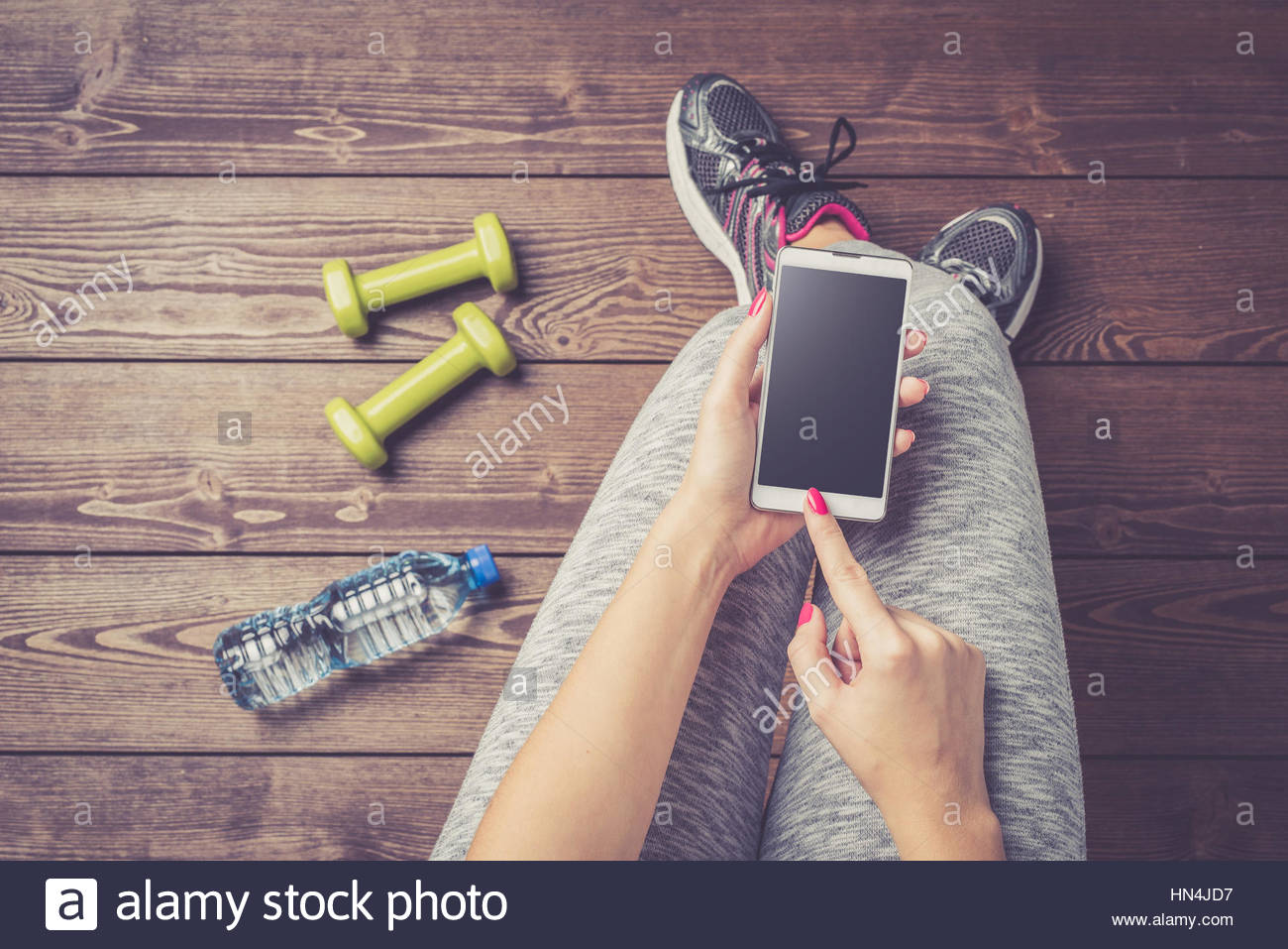 Weight Loss with Modern Devices - Stock Image