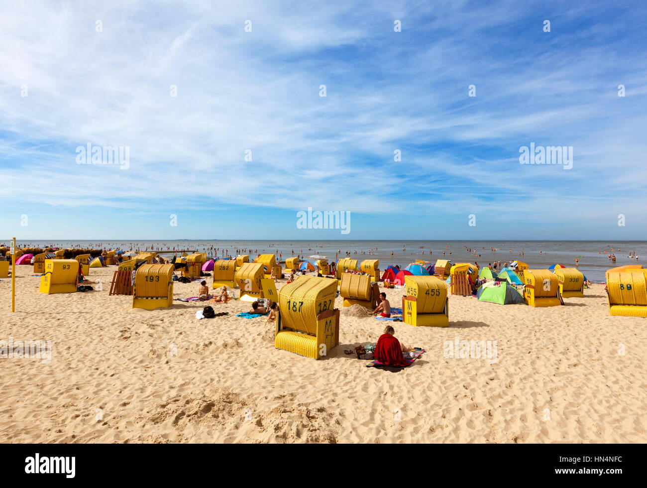 Cuxhaven, Germany - August 18, 2012: People enjoying the hottest day of the year at the beach of Duhnen with its - Stock Image