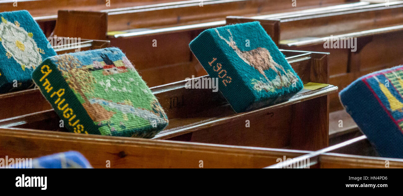 Hassocks displyed on pews in St Mary Magdelene church in South Molton - Stock Image
