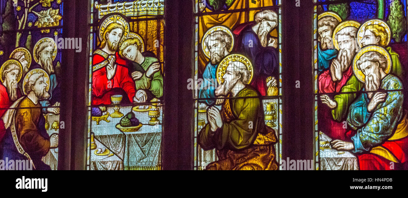 St Mary Magdelene church stained glass window in South Molton The window depicts the Last Supper with Christ about - Stock Image