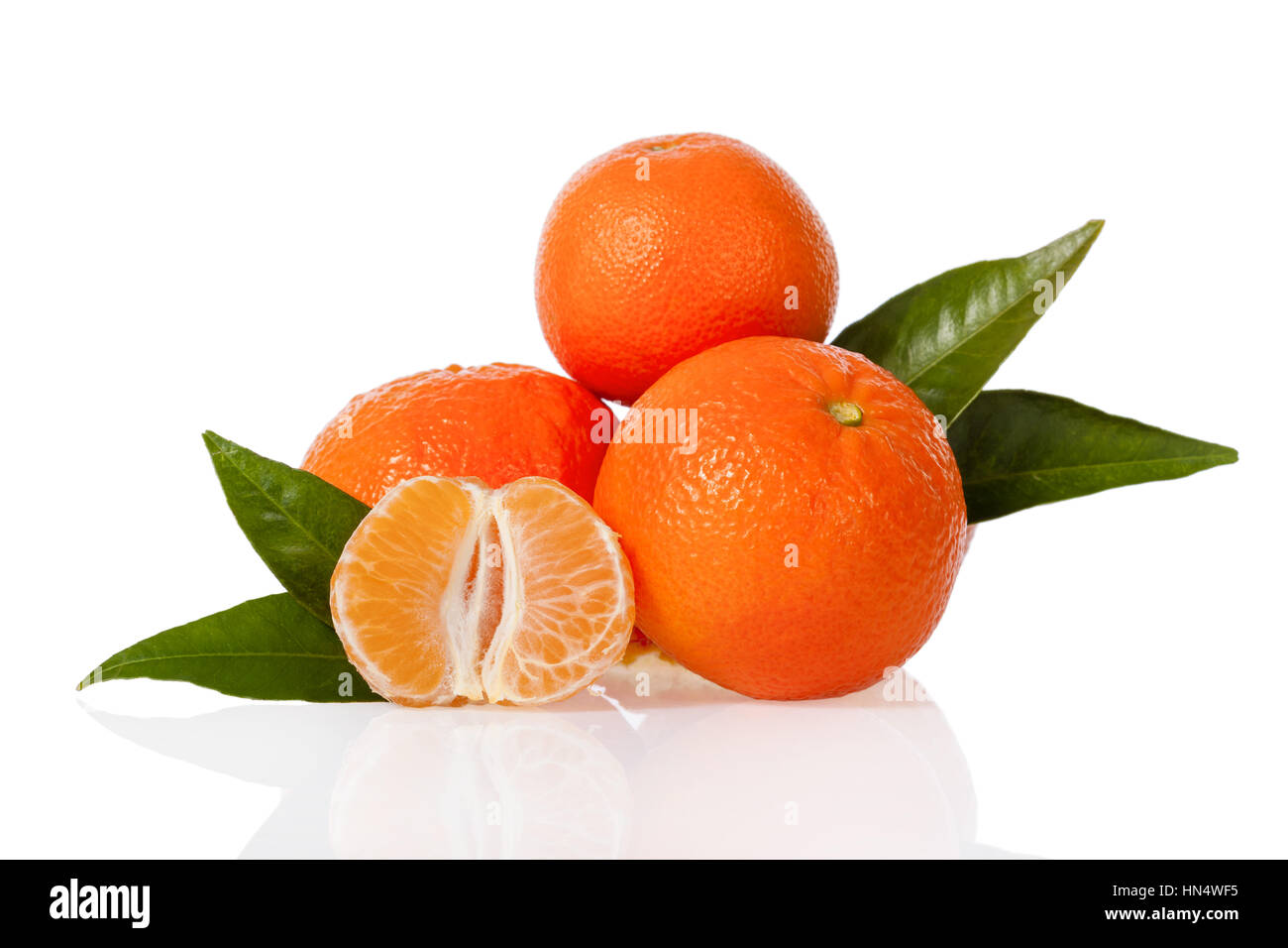 Clementines with a peeled clementine isolated on white background - Stock Image