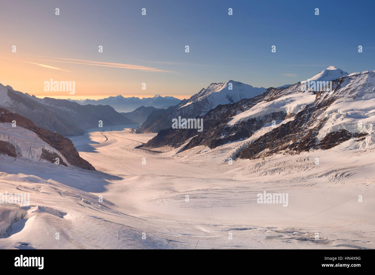 Sunrise over the Aletsch Glacier from Jungfraujoch in Switzerland on a clear morning. Stock Photo