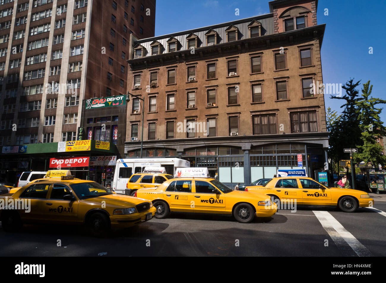 New York City, United States - September, 18 2008: New York City Yellow Cabs with taxi-top adverts, wait at traffic Stock Photo