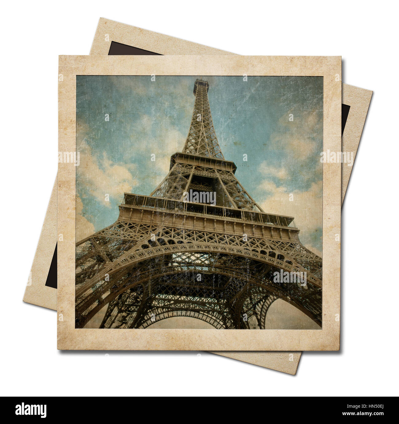 Vintage instant photo paper frames with Eiffel tower shot isolated on white - Stock Image