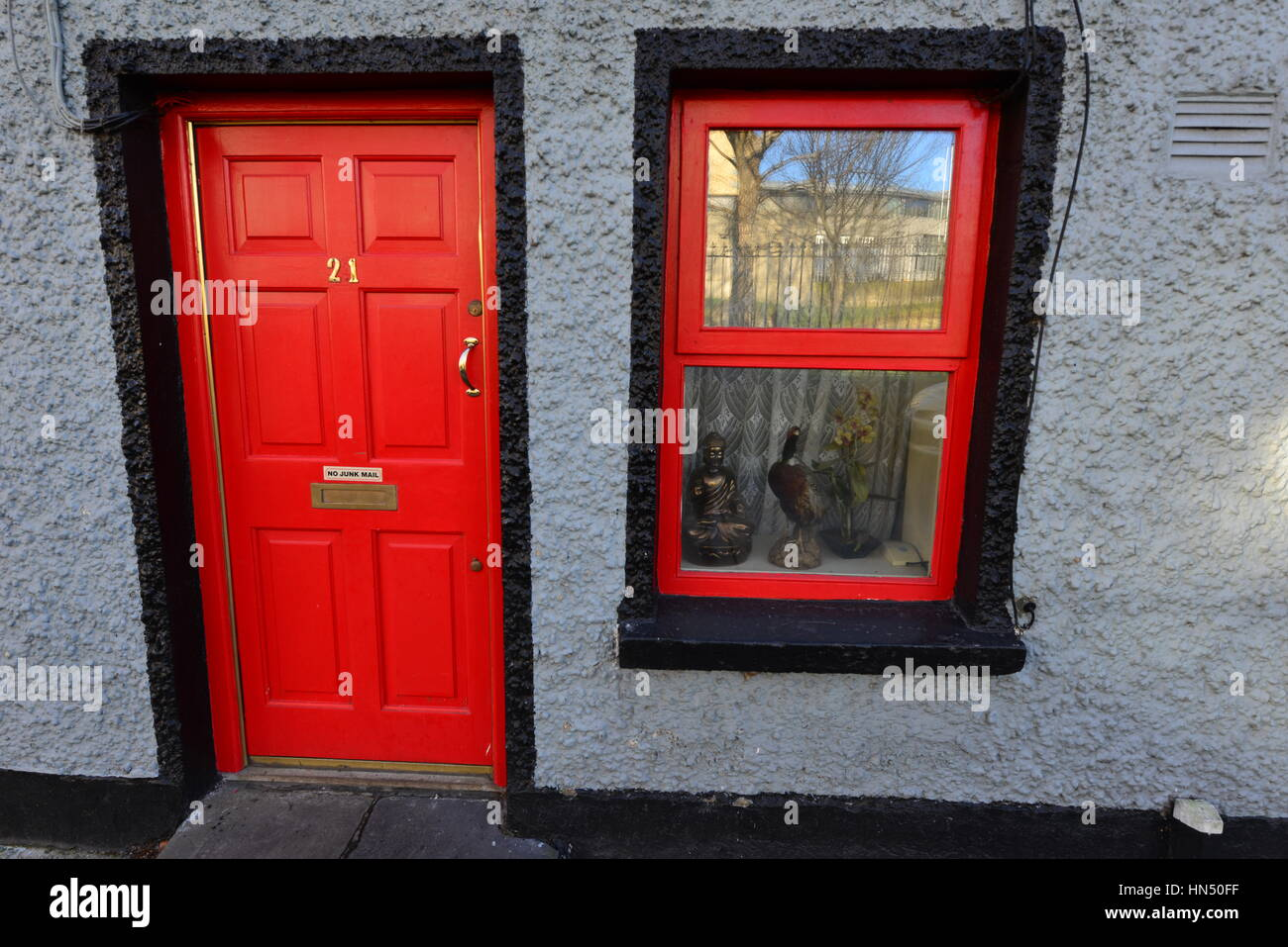Red door on a terraced house in Ireland - Stock Image