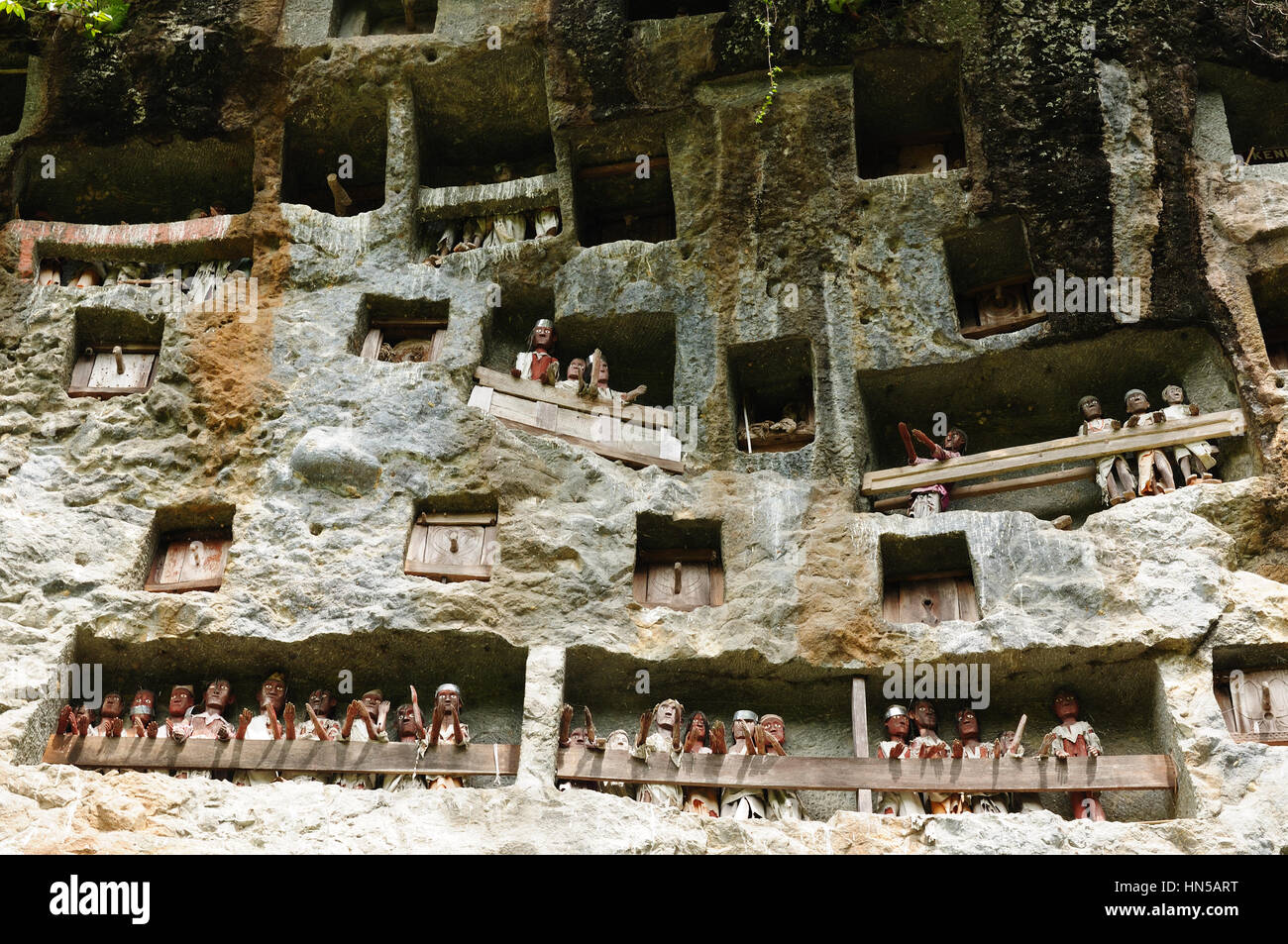 Tana Toraja - Londa, is a very extensive burial cave at the base of a massive cliff face.The entrance to the cave - Stock Image