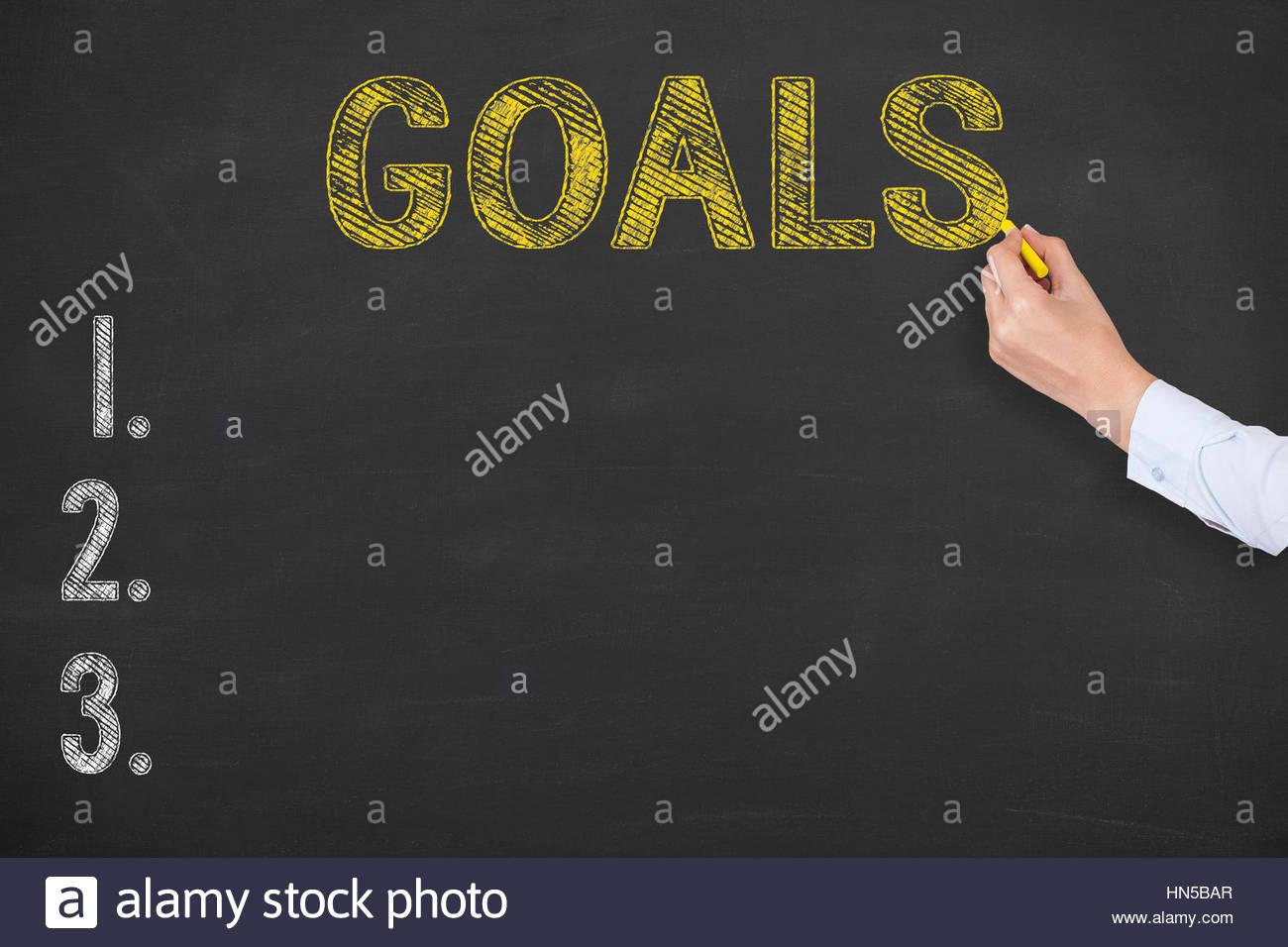 Goal List on Chalkboard Background - Stock Image