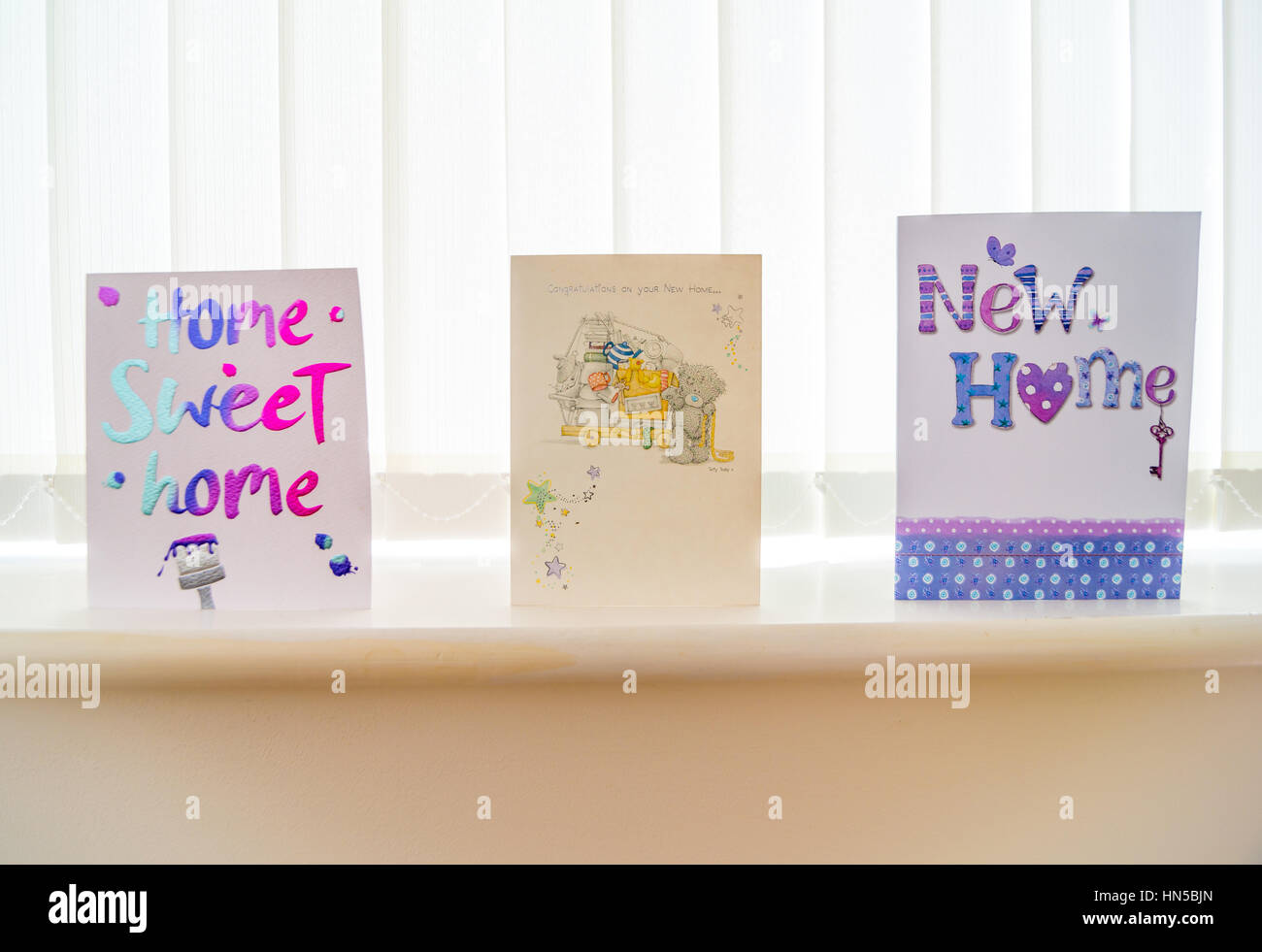 New home greetings card stock photos new home greetings card stock new home greeting cards arranges on a window sill stock image m4hsunfo