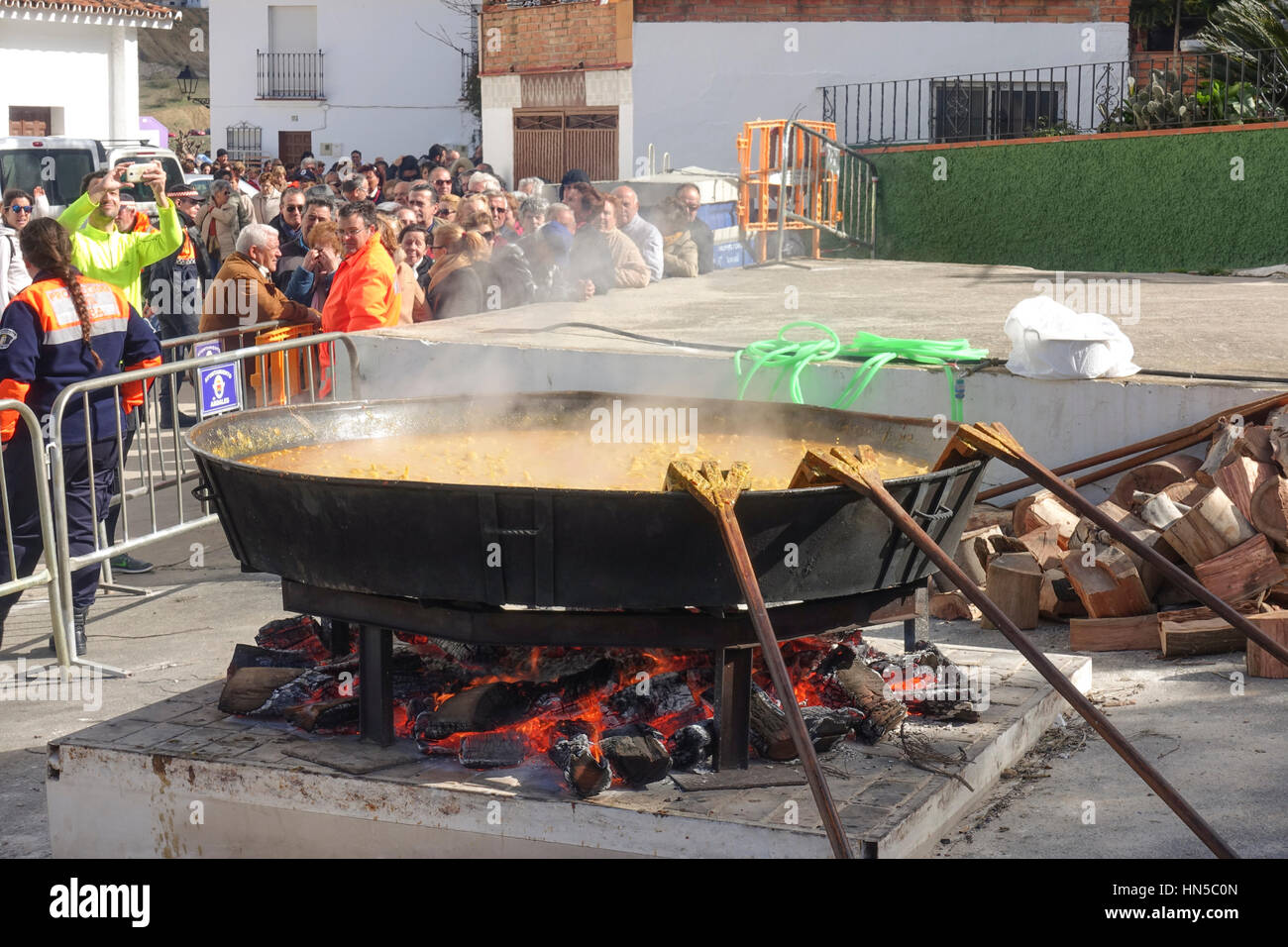 Huge pan with stew cooking on open fire at Fiesta de matanza, Annual Celebrations in Ardales.Andalusia, Spain. Stock Photo