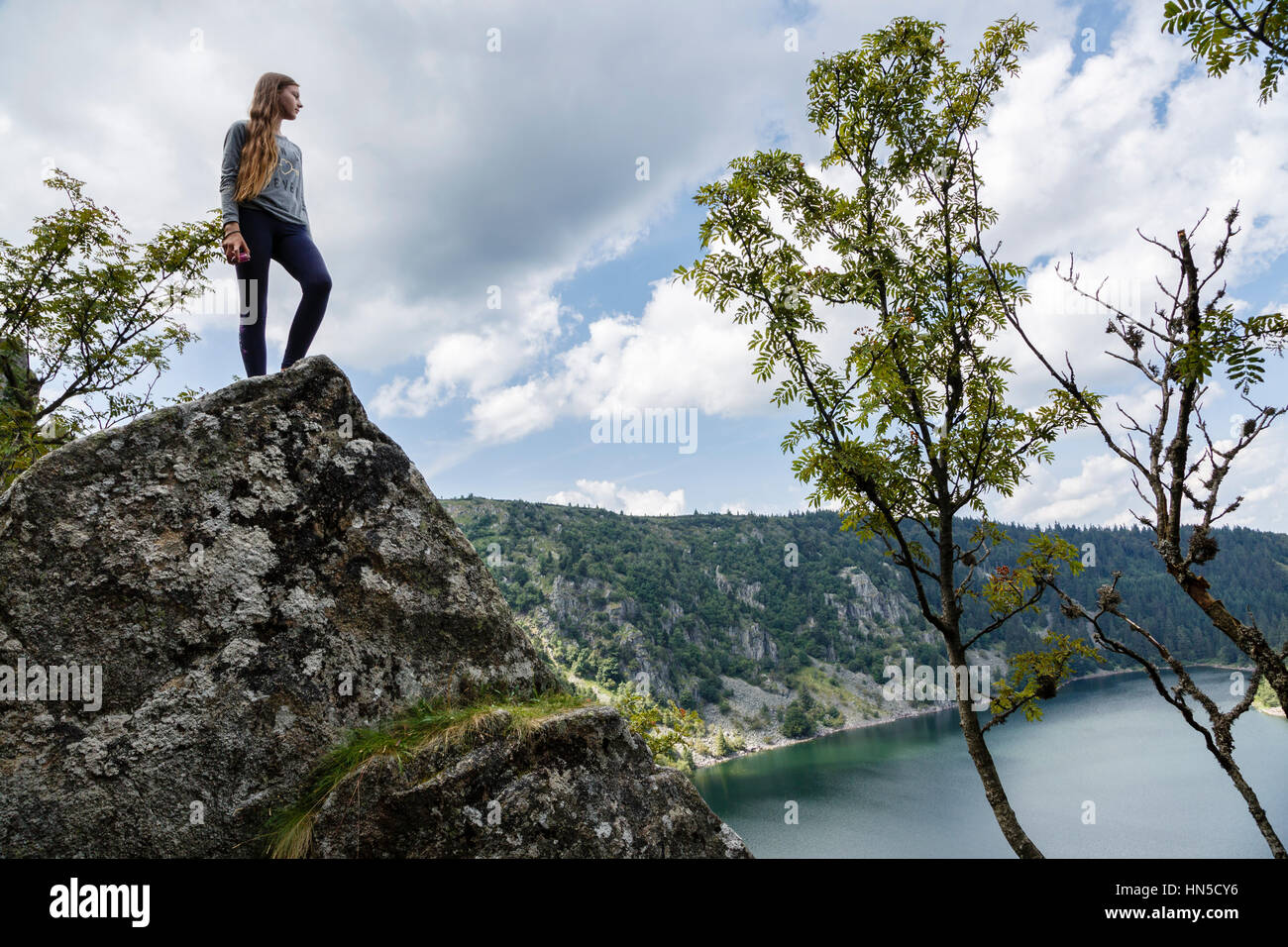 Girl admiring the view from Rocher Hans above Lac Blanc, Haut-Rhin, Alsace, France - Stock Image