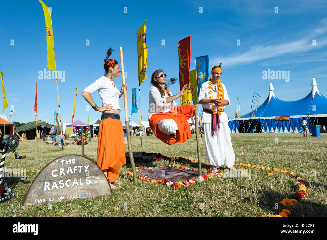 The Crafty Rascals Theatre company perform the floating man illusion at the Larmer tree festival, Dorset, England, - Stock Image
