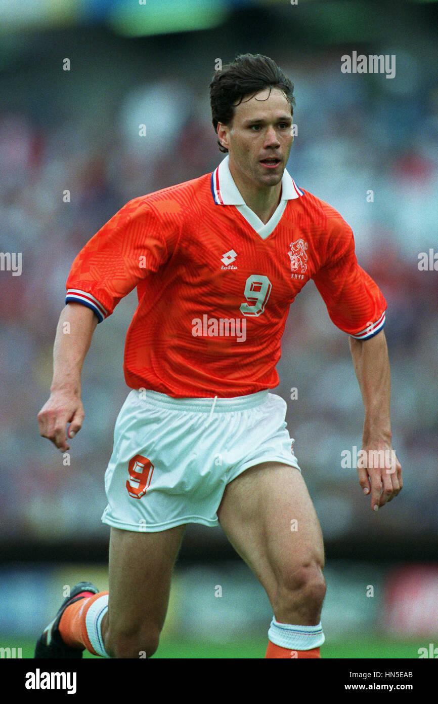 Dutch footballer Marco van Basten runs with the ball
