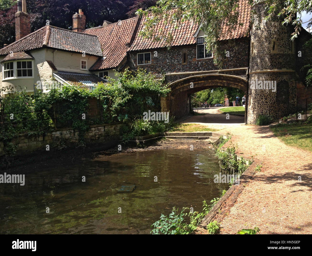 River Wensum and Pulls Ferry, a water gate for Norwich Cathedral, Norwich, Norfolk, East of England, UK Stock Photo