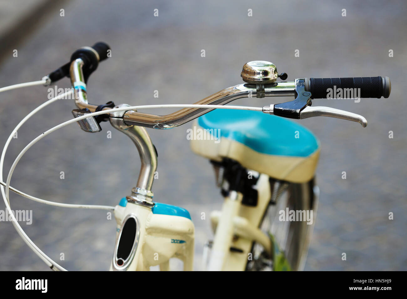 Bicycle is standing on the street of old European city - Stock Image