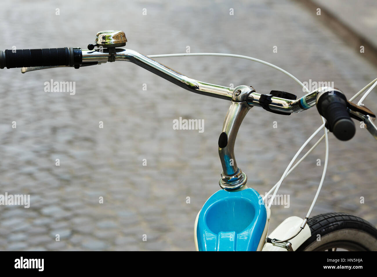 Helm of bicycle which is standing on the street of old city - Stock Image