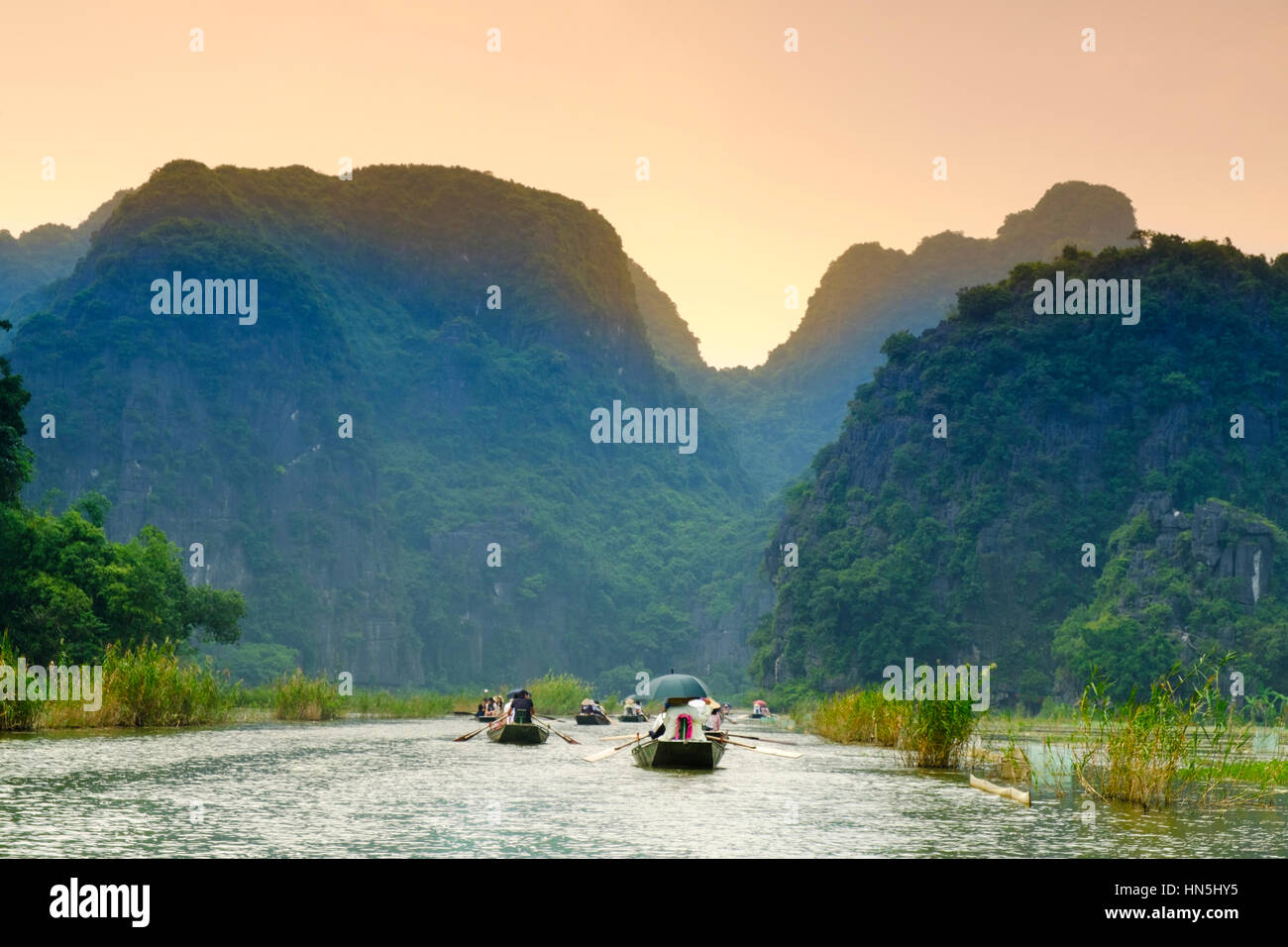 Tourist boats on the river in karst country in Tam Coc, Ninh Binh, North Vietnam Stock Photo