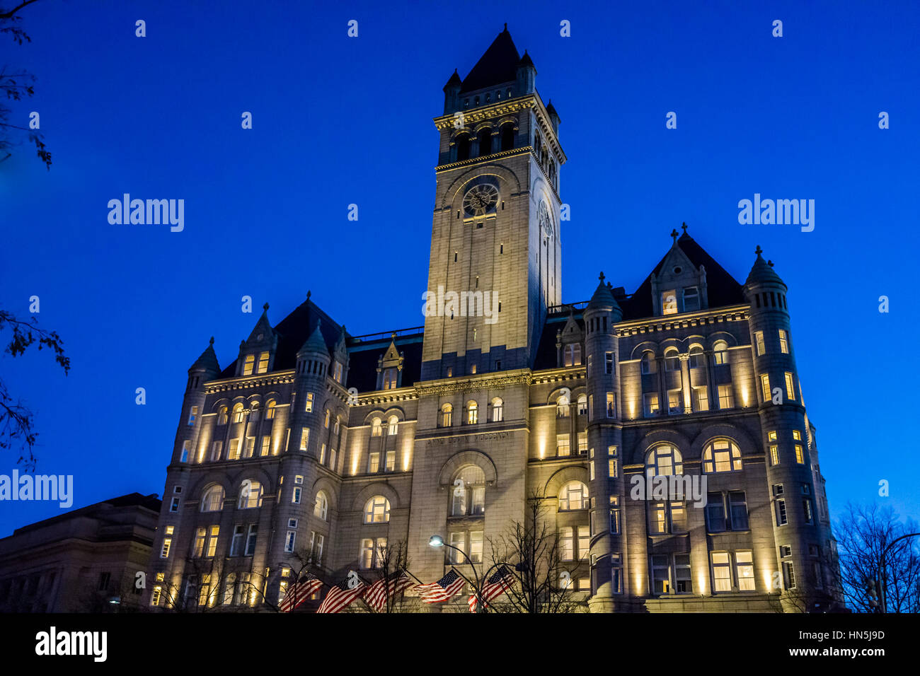 Washington DC, USA - December 29, 2016: Trump International Hotel and the Old Post Office Tower during blue hour - Stock Image