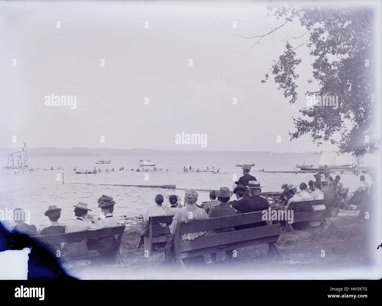 Antique August 22, 1900 photograph, swimmers and observers Bathing Beach on Chautauqua Lake, New York, USA. - Stock Image