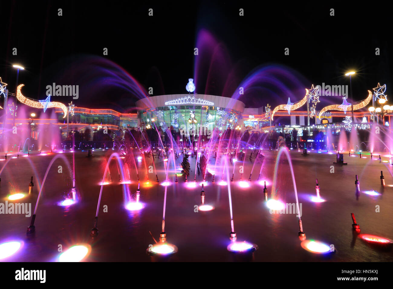Colorful fountain in night at Soho square in Sharm El Sheikh - Stock Image