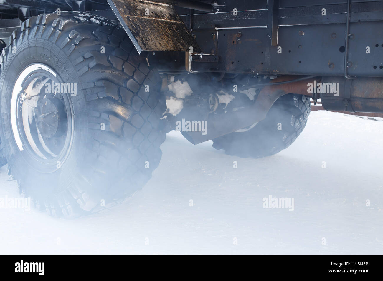 Photo of the exhaust gases of the truck. Fog and mist smoke air from the pipe car. - Stock Image