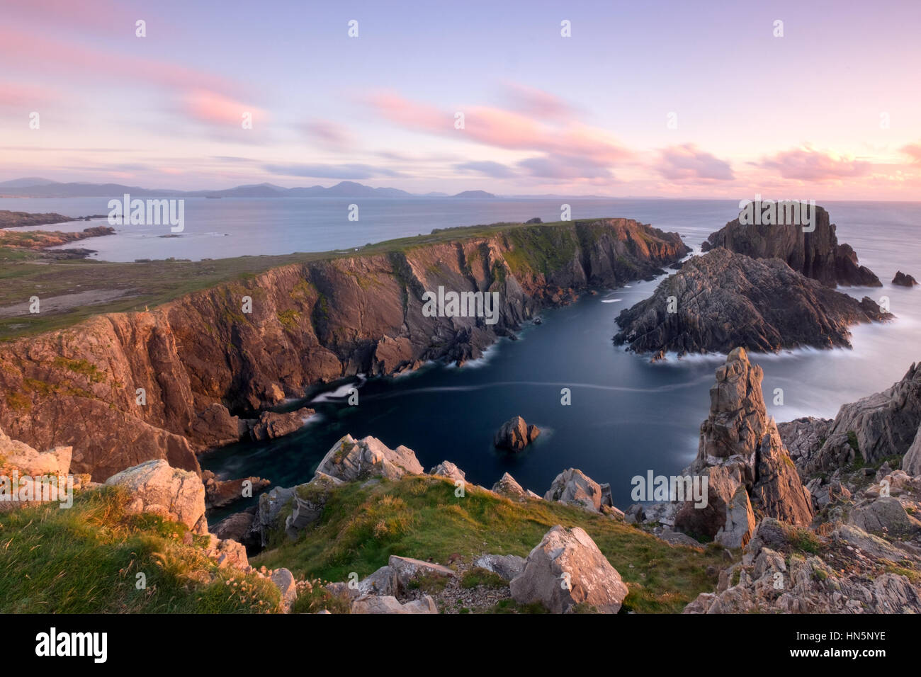 Sunset casts beautiful light over Malin Head on the North West Tip of Ireland in Co. Donegal. This location was - Stock Image