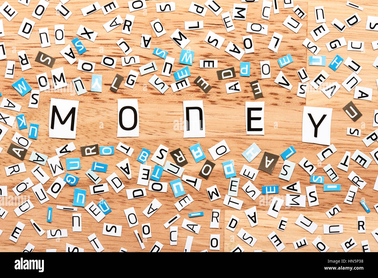 Money word from cut out letters on wooden table Stock