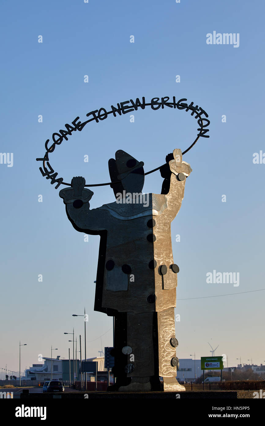 Metal public art statue landmark Welcome to artwork clown at New Brighton Fort Perch Rock and Marine Promenade in - Stock Image