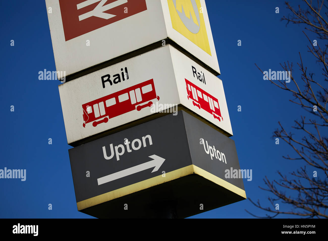 Blue sky on a sunny day, Upton railway station sign in Wallasey, Merseyside, Wirral, England, UK. - Stock Image