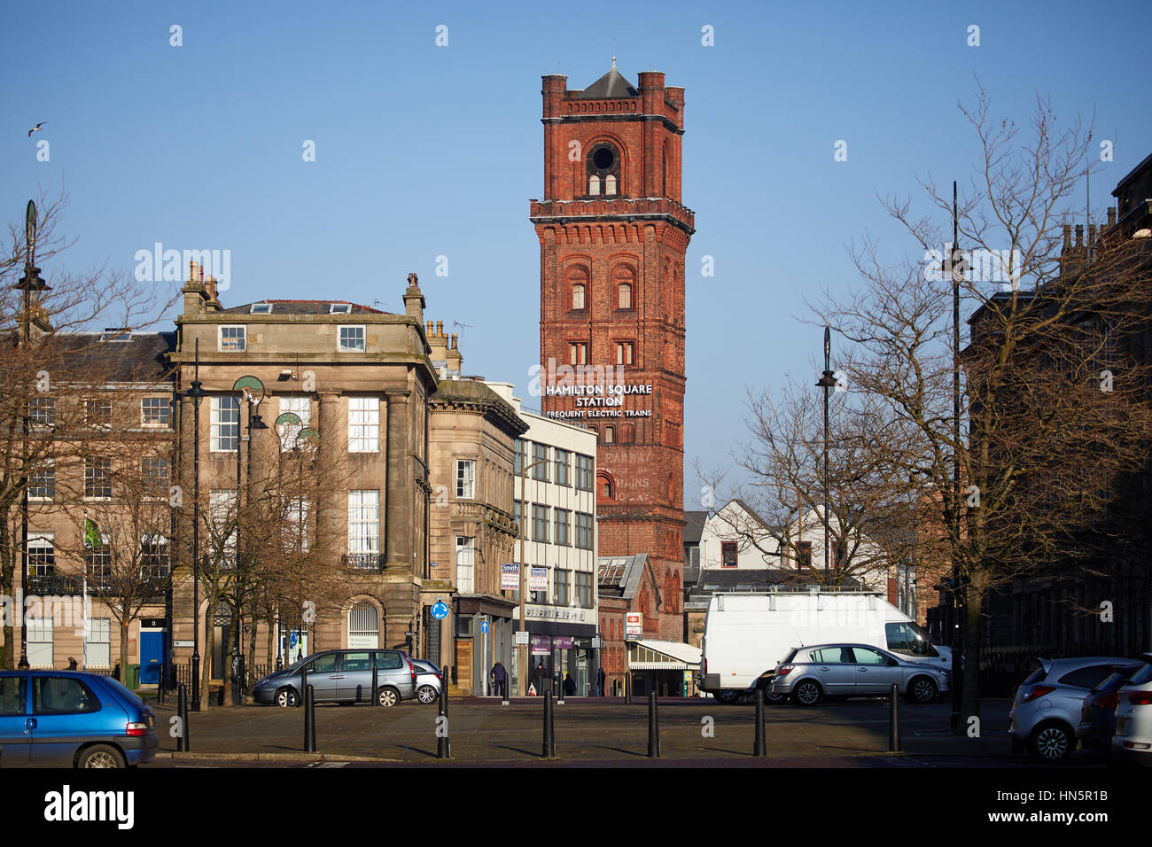 Blue sky sunny day at Birkenhead landmark exterior of Hamilton Square Station's brick victorian tower in Wallasey, - Stock Image