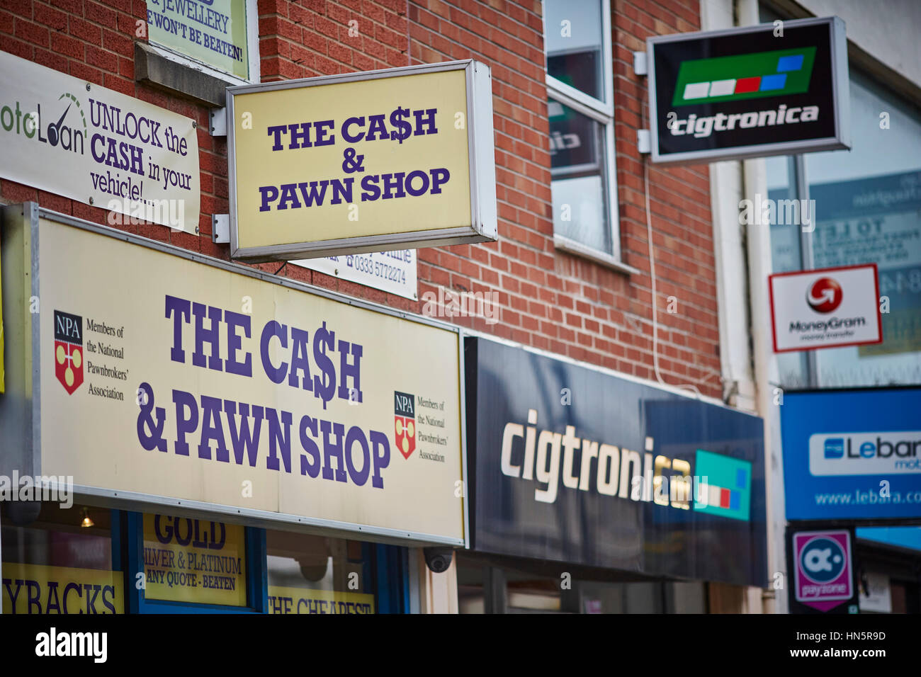 Exterior Close up of store sign outside The Cash & Pawn Shop sign Pawnbrokers in Bolton Town Centre, Lancashire, - Stock Image