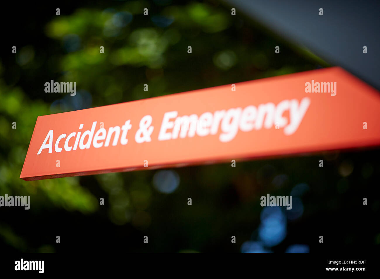 Red NHS Manchester Royal Infirmary MRI Accident and emergency Hospital information destination pointing A&E - Stock Image