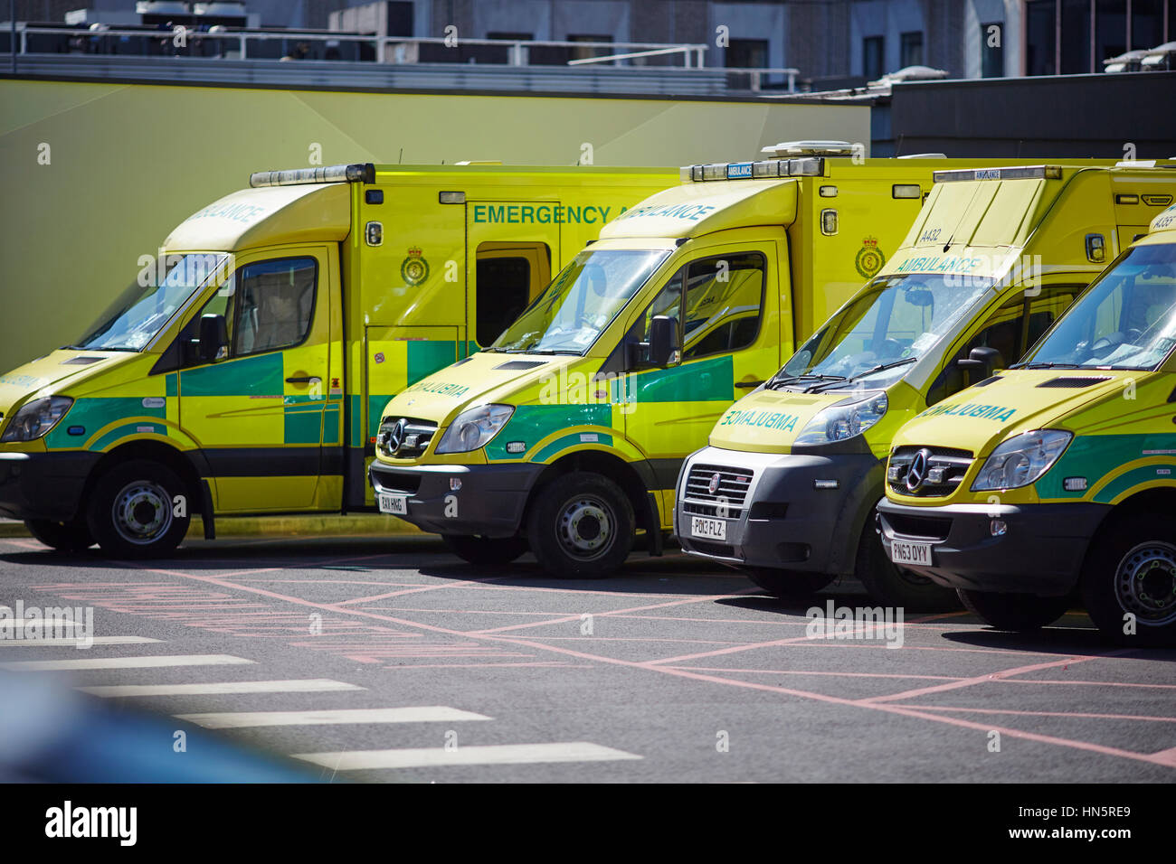 liveried ambulances parked on duty in designated bays at Manchester Royal Infirmary  accident and emergency department - Stock Image
