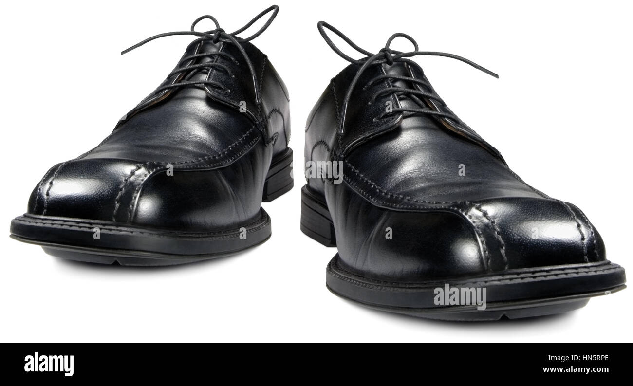 Classic men's black club shoes, isolated wide angle macro closeup Stock Photo