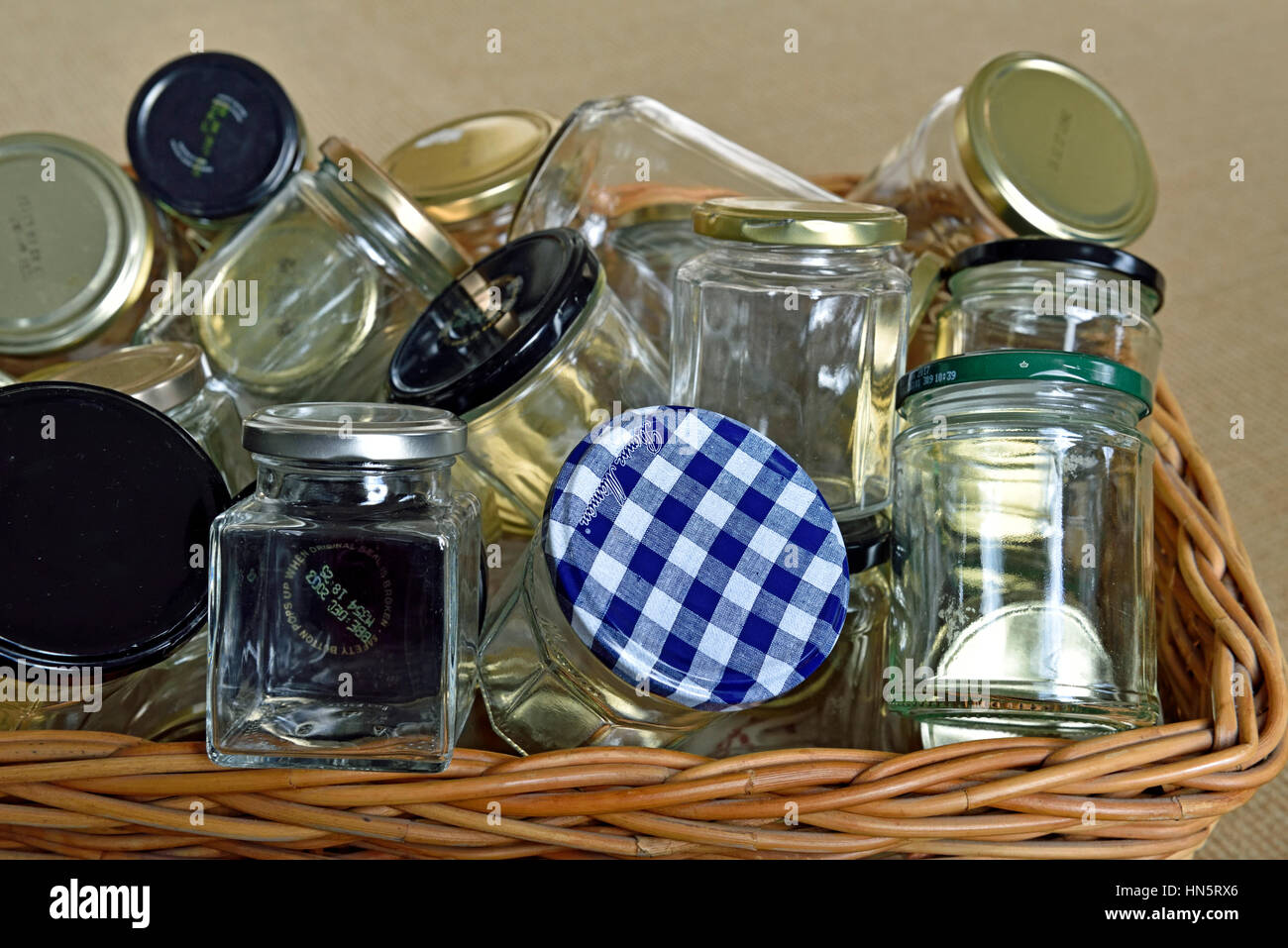 Empty glass jars in basket washed and ready for reuse, storage or recycling. - Stock Image