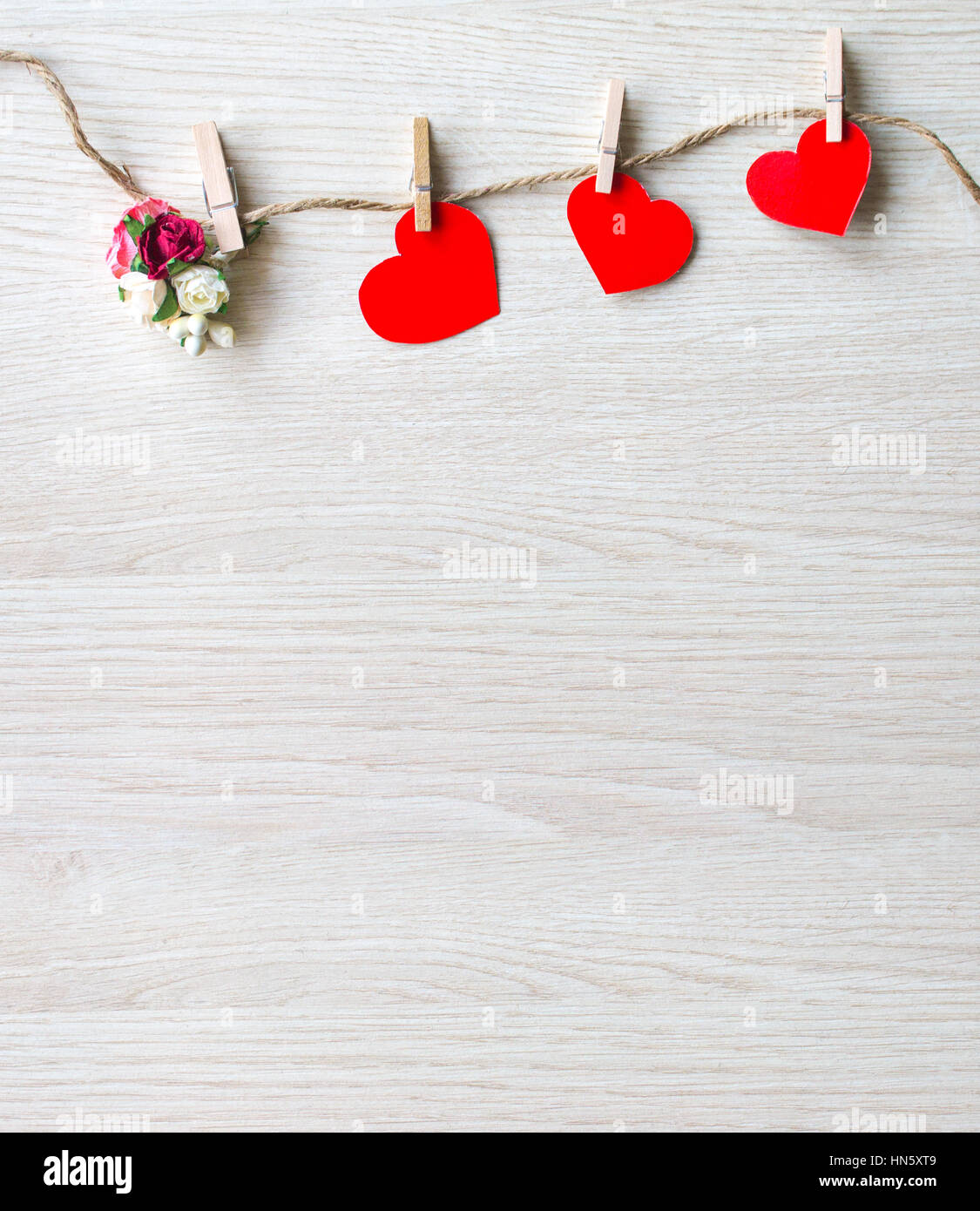 Red heart and bouquet of flowers from paper on a white background. The image by Day of St. Valentine. - Stock Image