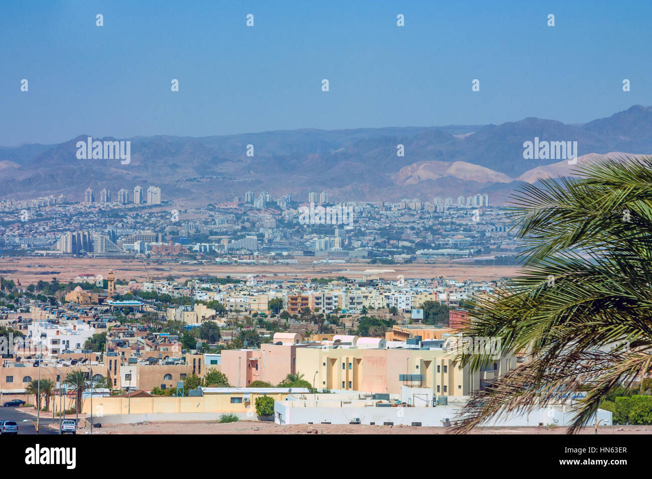View from Jordan city Aqaba to neighbouring Eilat city in Israel - Stock Image