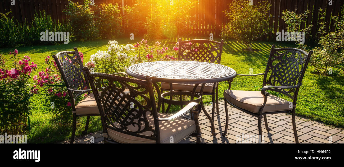 Chairs And Table In Front Of House Stock Photos & Chairs And Table ...