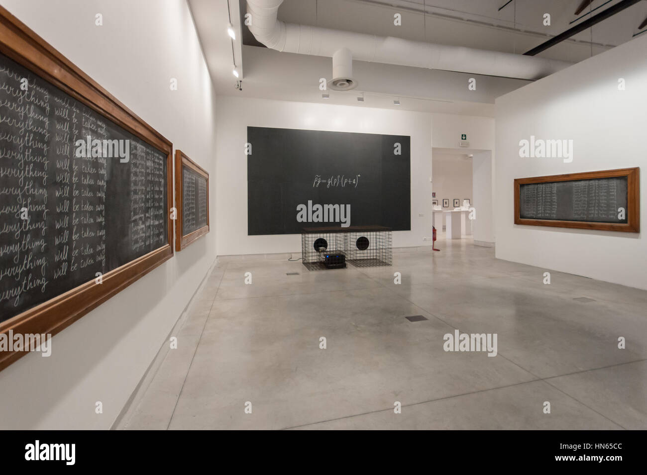 Venice Art Biennale 2015: artworks Everything #21 by Adrian Piper (sides) and I numeri malefici by Fabio Mauri (in - Stock Image