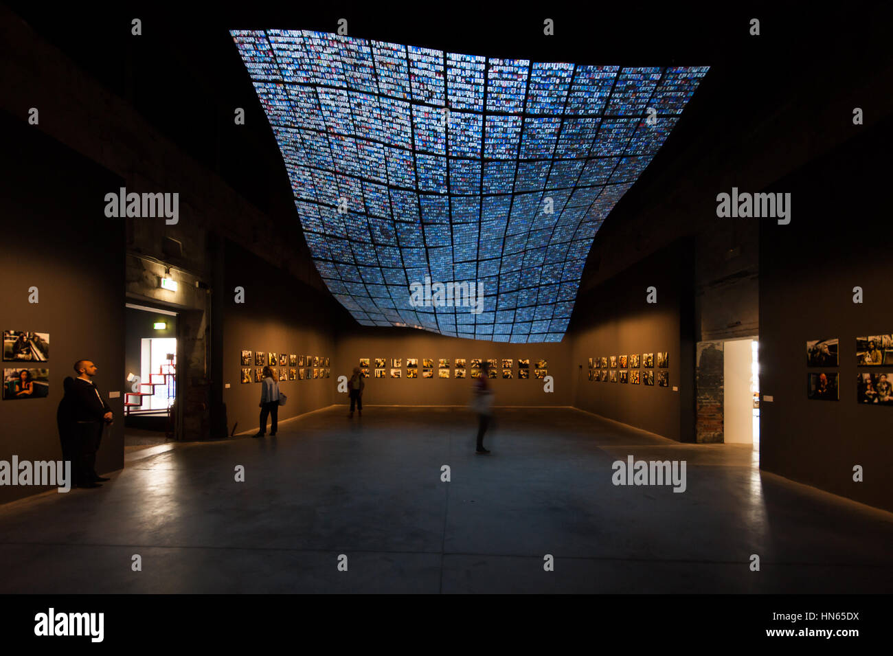 Venice Art Biennale 2015, The installation The portrait of Sakip Sabanci by Kutluğ Ataman (ceiling) and Chris Marker, - Stock Image