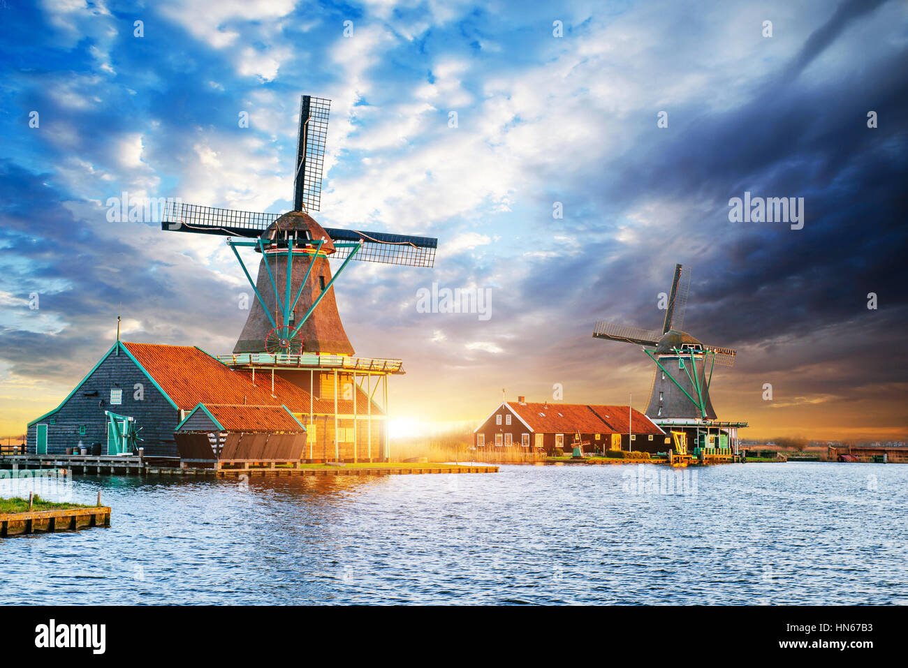 Cumulus clouds on sunset over dutch windmills in Rotterdam. Neth - Stock Image