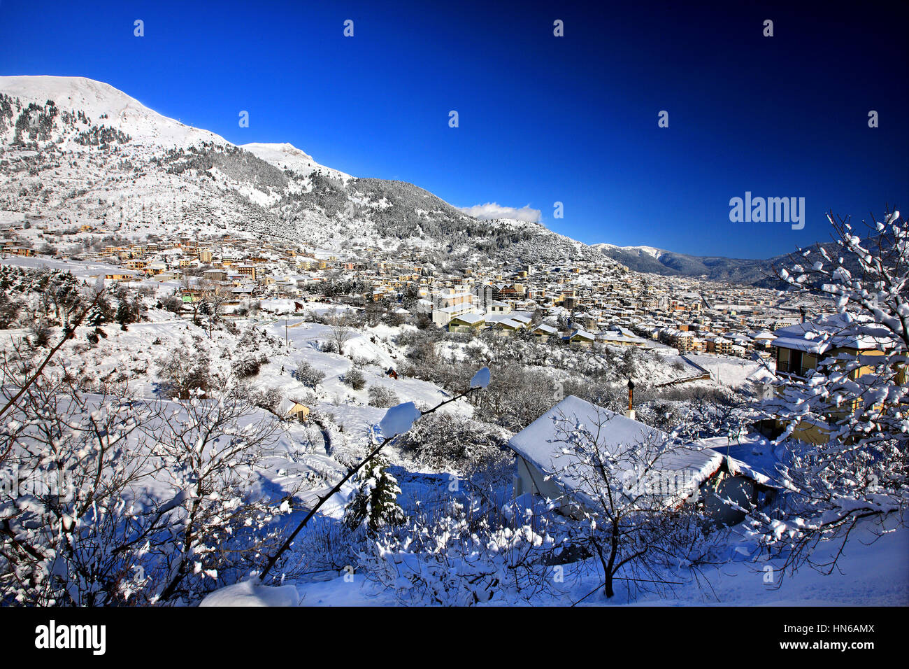 View of Karpenissi town and Velouchi (or 'Tymphristos') mountain. Karpenissi is the 'capital' of - Stock Image
