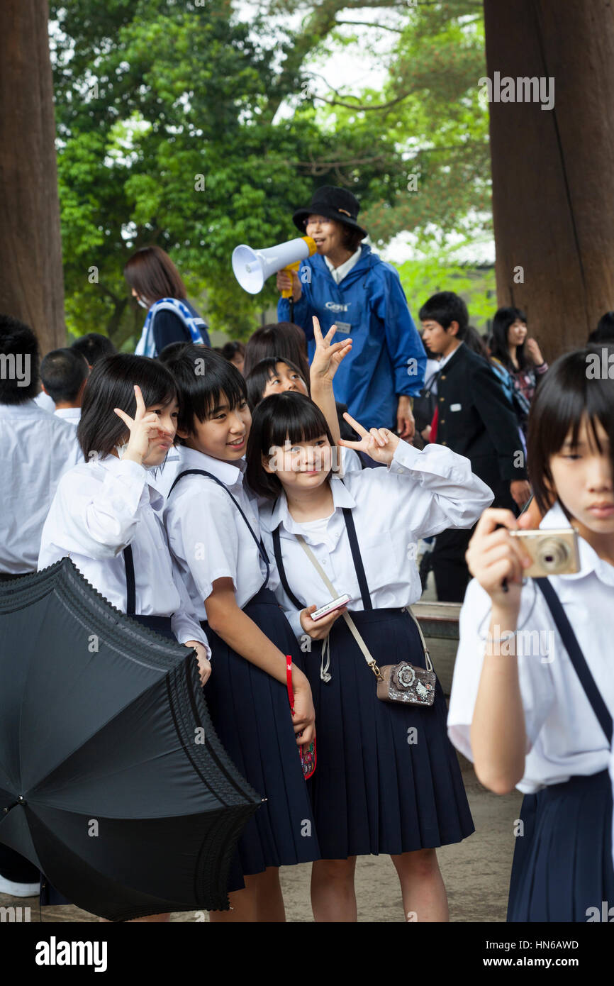 Nara, Japan - May 9, 2012: Japanese school children pose for a photograph whilst on a school trip to Todai-ji temple, - Stock Image